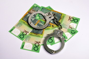 Australische 100 Dollarscheine mit Handschellen