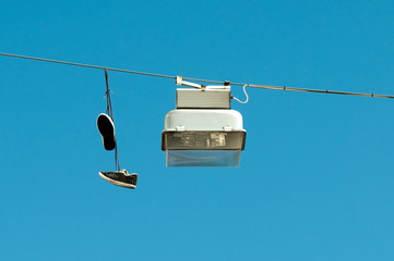 Street lamp and sneakers on blue sky