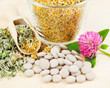healing herb in glass cup, tablets, herbal medicine