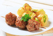 Meatball skewer and potatoes