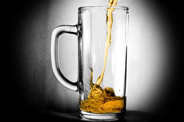 filling a glass of beer
