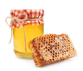 Jar of honey and honey honeycombs