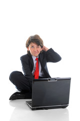 boy in business suit sitting in front of computer