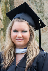 Female College Graduate in Cap and Gown