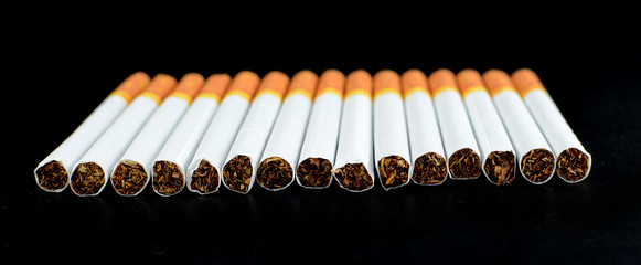 cigarettes on black background
