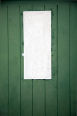 paper on weathered wood door