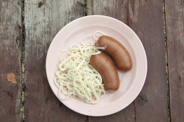 Macaroni and small sausages