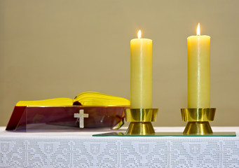 Bible Golden and two burning candles
