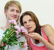 Young couple in love with Peonies
