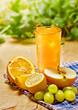 Juice, orange, apple, grape and lemon on the table, outdoor