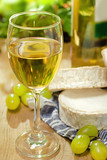 White wine, Brie, Camembert and grape on the table, outdoor