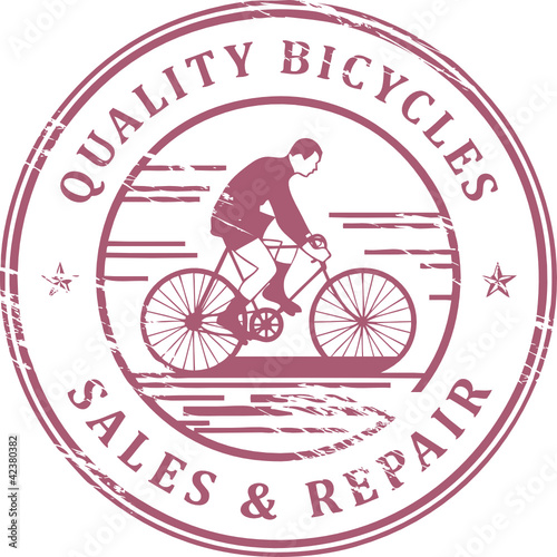 Stamp with bicycle and the words Quality Bicycles inside, vector
