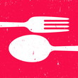 Cutlery on red background