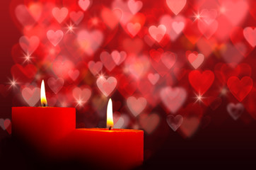Burning candles with hearts bokeh