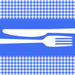 Cutlery on blue tablecloth