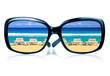 Sunglasses with a tropical beach reflected on them