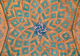 Brickwork mixed with blue tiles inside an old mosque