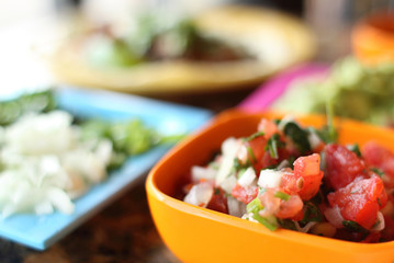 Salsa and sides in bowls at a Mexican restaurant.