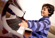 Boy excited about piano lessons
