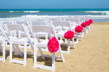 Chairs set up for wedding on the beach