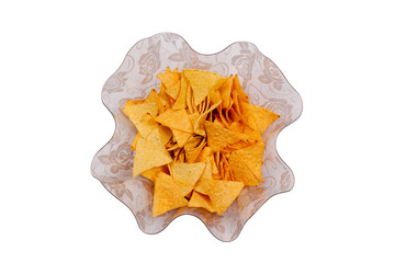 A wavy glass bowl with nachos isolated on a white background, vi