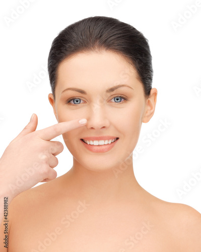 beautiful woman pointing to nose
