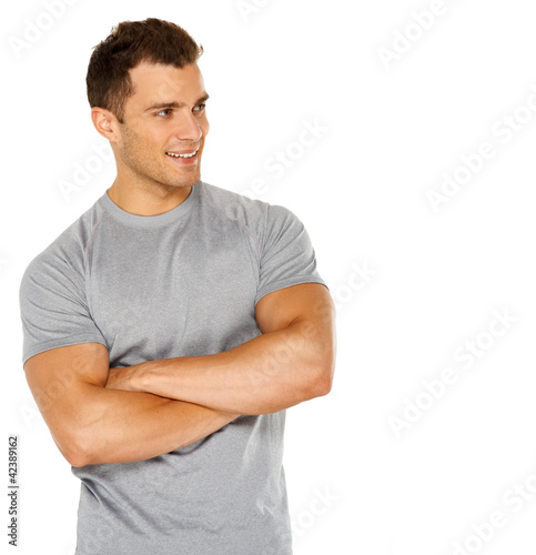 Handsome man with arms crossed looking his left on white
