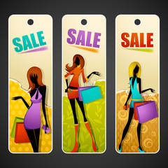 Lady with Shopping Bag on Sale Tag