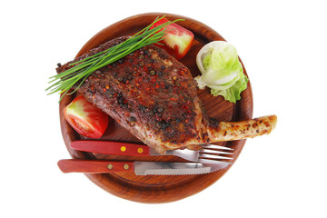 meat savory on wooden plate: roast shoulder