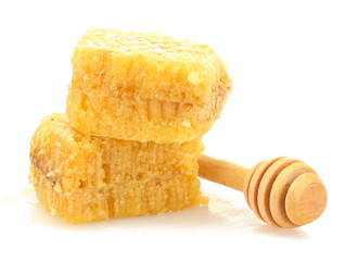 golden honeycombs and wooden drizzler isolated on white.