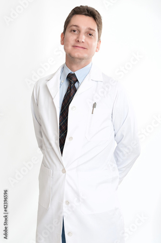 Smiling man on tie and lab coat