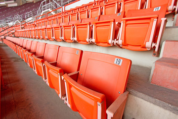plastic seats in very big, empty stadium