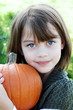 Child Holding a Pumpkin