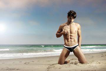 Fit man on beach