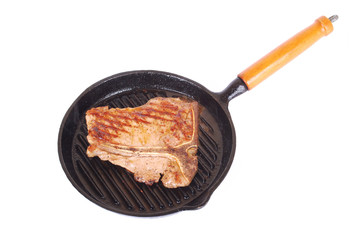Steak sizzling in pan