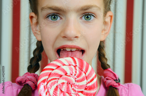 girl with a big candy lollipop