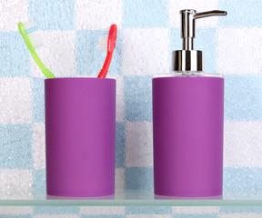 Bath accessories on shelf in bathroom