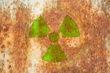 radioactivity warning symbol on metal surface rust.