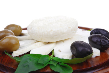 white cheese with olives and basil