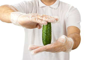 Man in white shirt holding cucumber