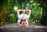 Couple yoga in garden