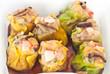 steamed shrimp dumplings in foam box with sauce