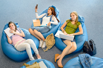 Group of students lying on beanbag relax
