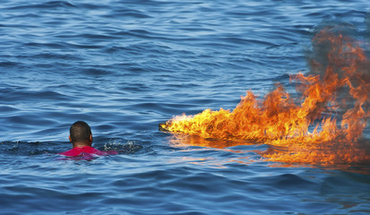 Fire on water with rescuing man