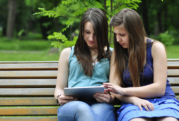 girls  using a tablet pc