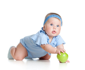 Baby girl with green apple, isolated on white