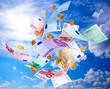 Euro banknotes and coins falling from blue sky