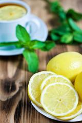 Lemons and tea with mint