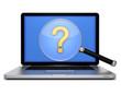 Laptop mit Lupe mit Fragezeichen