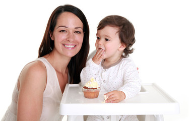 Mother and baby eating cake